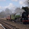 On its first mainline outing after winter maintenance on the Mid Hants, 60163 Tornado, runs through West Byfleet with its support coach back to Southall<br /> <br /> 8 March 2012