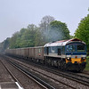 59104 rolls through West Byfleet with 7V92 Woking - Acton stone empties<br /> <br /> 2 May 2012