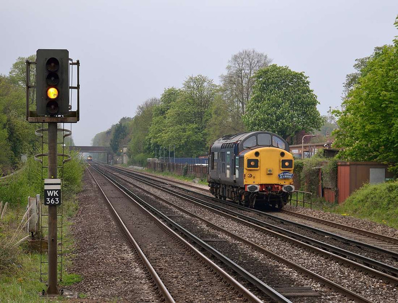 37087 races through West Byfleet with 0Z31 14.45  Eastleigh - Willesden light engine move<br /> <br /> 2 May 2012