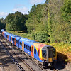 Desiro 450085 forming  the 11.43 Basingstoke - Waterloo <br /> seems to blend with the lineside show of autumn colours at Pirbright<br /> <br /> 4 October 2012