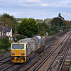 MPV DR98977 passes Worting as 3S85 07.45 Eastleigh RC - Eastleigh RC via Weymouth<br /> whilst 66540 restarts 4O51 Wentloog - Southampton Maritime from a signal check.<br /> <br /> 10 October 2012