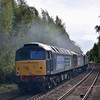 47828 leads  47802 and 47818 through Bramley with 0Z48 from Crewe Gresty Bridge - Eastleigh T+RSMD<br /> The shot was snatched at the last moment after being bowled by the up service train which had just drawn into the platform<br /> <br /> 3 October 2012