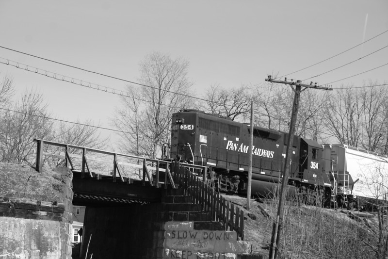 Pan Am Railways 354 heading westbound at the Intervale Rd bridge in Fitchburg, MA.