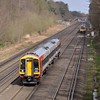 159015 in Oatlands Cutting Weybridge with 1L43 the 14:50 Waterloo to Salisbury service<br /> <br /> 16 April 2013