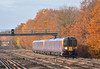 450547 passes the colourful lineside vegetation between Walton and Hersham with 2L32 the 10.16 Basingstoke and Alton to London Waterloo<br /> <br /> 8 December 2013