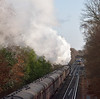 The driver of the 11.03 from Weybridge to Waterloo has a pefect grandstand view of 'Black Fives' 44871 / 45407 as they draw away from Virginia Water with 1Z82 The Cathedrals Express from Southend Central - Chichester<br /> <br /> 14 December 2013