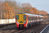 Marking 'Movember' !<br /> <br /> Wearing its 'Movember' moustache, 8016 leads 8030 past Hersham with the diverted  2C27,10.39 from Waterloo to Reading<br /> <br /> 8 December 2013