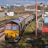 66185 unloads hoppers in Woking Down Yard  having brought in 7Y55  from Angerstein Wharf. <br /> It will later return the empty wagons as 7V92  Woking  - Acton Yd<br /> <br /> 14 February 2013