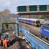 The new footbridge at Horton Road sees 165110  head towards the capital with 1P43 <br /> 1150 from  Moreton-in-Marsh  passing HST 43002 at the head of 1C84 1306 Paddington to Plymouth<br /> <br /> 4 February 2013