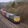 66563 winds around the curves outside Tilehurst with 4O51 Wentloog - Southampton Maritime freightliner<br /> <br /> 7 February 2013