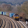 Weak sunshine lights the vegetation as 66193 brings freightliner 4O53<br />  the 08.42  Bescot - Southampton W.Docks through the Thames valley near Pangbourne<br /> <br /> 15 February 2013
