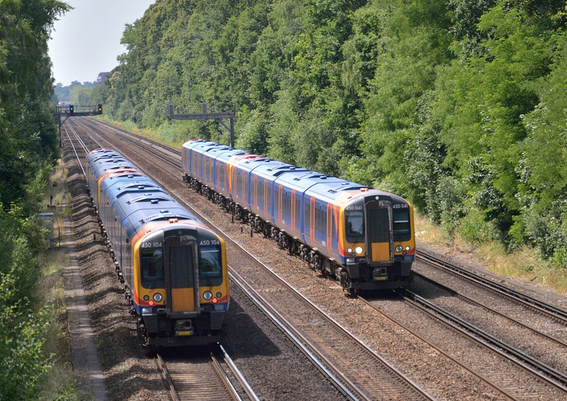 450041 races towards Waterloo with 2P40 the12.39 from Haslemere<br /> passing classmate 450104 at Sheerwater with 2L35 service to Basingstoke<br /> <br /> 15 July 2013