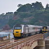 153368 slows to a halt at Dawlish with a Paignton - Exmouth service as a Cross Country HST passes in the opposite direction<br /> <br /> 7 July 2013