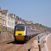 Class 43 Power Car 43207 runs along the sea wall at Dawlish with Cross Country service 1V46 the 06.32 from York to Plymouth<br /> Despite the 80f heat there are surprisingly few holidaymakers on the beach<br /> <br /> 8 July 2013