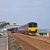 150122 draws out of Dawlish bound for Paignton on a quiet Sunday afternoon<br /> <br /> 7 July 2013