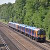 Desiro 450113 leads 1A38 the 12.28 Farnham to Waterloo past Sheerwater<br /> <br /> 15 July 2013