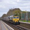 66515 thunders through Addlestone with 6O49 Neasden-Wool empty sand hoppers<br /> <br /> 29 April 2013