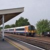 444035 hurtles through Hersham with the 11.45 Portsmouth Harbour to  Waterloo<br /> <br /> 3 September 2013