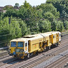 Colas Rail DR73930 <br />  - Plasser & Theurer 08-4x4/4S-RT Switch & Crossing Tamper returns north through Kenton <br /> on a circular trip from Nuneaton  to Bletchley Cambridge Sidiings via Willesden<br /> <br /> 2 September 2013