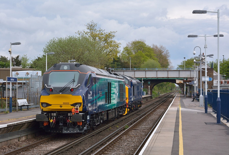 Making a debut daylight appearance, 68002 is hauled through Ashford by 37423 as 0Z68 Eastleigh to Willesden via Woking   22 April 2014