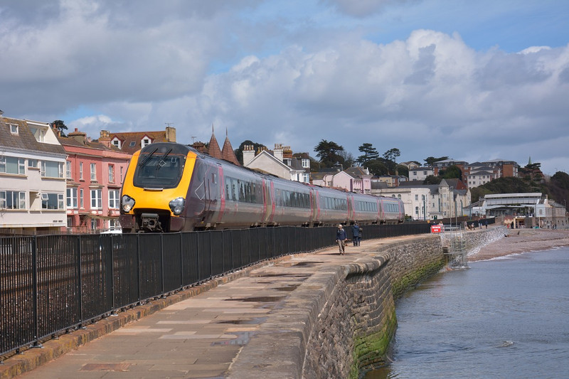 New railings along the sea wall and some scaffolding around damaged steps are amongst the changes visible to 1V48 as it passes Dawlish with the 06.45 from Newcastle to Plymouth  8 April 2014