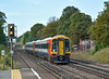 158884  leads 1L28 through West Byfleet with the 07.25 from Exeter St Davids to London Waterloo.<br /> <br /> 21 August 2014