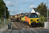 Colas70806 about to cross Station Road, Egham with 6Y41 engineers train from Eastleigh Yd - Hoo Jn,<br /> <br /> 29 August 2014