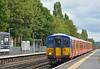 5711 streaks through West Byfleet as 5B39, ECS working from  Wimbledon Park Depot Sidings to Bournemouth T&R.S.M.D
