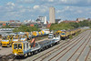 Sharing the yard at Woking, are Balfour Beatty flatbed track machine DR98220  and C2103 Network Rail Loram rail grinder <br /> Just visible behind the road/rail machines is DR 98217<br /> <br /> 22 August 2014