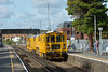 Network Rail Stoneblower DR80205 closely followed 6Y41 through Egham working to Rugby from Woking Yard.<br /> <br /> 29 August 2014
