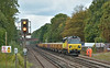 Running almost an hour late, Colas 70802 slogs along near West Byfleet with 6Y41 daily engineers working from Eastleigh - Hoo Jn Up Yd,<br /> <br /> 28 August 2014