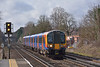 Seen here catching some reluctant sunlight on the approach to West Byfleet, <br /> Desiro 450029  forms  2B36 the 09.50 service from Poole to London Waterloo.<br /> <br /> 25 February 2014