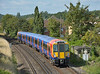 458533 rolls into Egham with 2S24 the 09.33 service from Weybridge to London Waterloo<br /> <br /> 30 July 2014