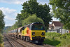 Colas 70808 + HQAJ Autoballasters pass St Johns Way, Chertsey with 6Y42 from Hoo - Eastleigh.<br /> <br /> 18 June 2014