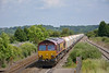 EWS liveried 66150 rolls down to the Severn Tunnel through Pilning with the Hayes & Harlington to Moreton-on-Lugg empty hoppers<br /> <br /> 20 June 2014