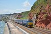 FGW Class 57 No. 57605 'Totnes Castle' passes Dawlish with 2E75 the 1125 from Par to Exeter St Davids. formed of coaching stock from the previous nights sleeper train.<br /> <br /> 21 June 2014