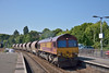 66164 passes Newton Abbot with a Saturday working of clay wagons from Burngullow to Exeter Riverside.<br /> <br /> 21 June 2014