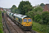 Freightliner 66619 races through Egham with 6O49 sand empties from  Neasden Charrington  to Wool.<br /> <br /> 19 June 2014