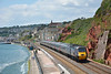 Cross Country HST led by power car 43303  forms 1S51 the 1235 from Paignton to Glasgow Central<br /> The security guard on the wall is remonstrating with two walkers as they wandered along the lower stretch of the sea wall at Dawlish for a closer look at the work site.<br /> <br /> 21 June 2014