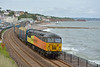 Colas 56113 thunders through Dawlish with the Chirk Kronospan  to Teigngrace empty log carriers. The choppy sea  and low cloud was in contrast the the previous few sunny days.<br /> However, what else might you expect in England in June!<br /> <br /> 25 June 2014