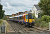 Class 458/5 Desiro 458534 arrives at Egham with  2S32 11.33  service from Weybridge to London Waterloo<br /> <br /> 10 August 2016