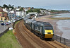 The beach at Dawlish is surprisingly quiet as a full HST set in GWR green  livery  led by power car 43041 speeds past with 1C83 13.05 service from Paddington to Penzance<br /> <br /> 6 July 2016