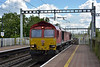 DB Class 66 No.66118 rumbles through Pangbourne at the head of a rake of empty container flats running as  4E69 from Southampton W Docks  to Wakefield Europort<br /> <br /> 25 April 2017
