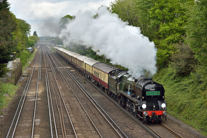 Bulleid Light Pacific No.34046 'Braunton' renumbered as 34052 'Lord Dowding' steams past West Byfleet working 1Y82 Belmond British Pullman luncheon train for a trip around the Surrey Hills from Victoria<br /> <br /> 28 April 2017