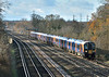 Desiro 450029 approaches Weybridge at the head of 2P32  the 10.39 Haslemere to London Waterloo in bright winter sunshine.<br /> <br /> 8 December 2017