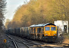 GBRf Class 66 No.66751  ' Inspiration Delivered' emerges from the shadows on the approach to Virginia Water heading  4Y19 from Mountfield Sidings  to Southampton W Docks <br /> <br /> 19 January 2017