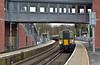 Framed by the new footbridge at Virginia Water Desiro 458518  halts in Platform 3  forming 2S38 13.03 service from Weybridge to  Waterloo<br /> <br /> 8 March 2017