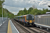 Desiro 450027 slows to a halt at Virginia Water working 2C38 /12.42 from Reading to London Waterloo<br /> I took the shot to record the new extended platforms at the 'country end' now in use.<br /> <br /> 2 May 2017