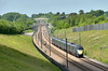 Class 395 Javelin No.395027 is just about to dip out of the sunshine as it speeds past Lenham Heath  forming 1L32 12.37  service from St Pancras International to Dover Priory and return.<br /> <br /> 25 May 2017