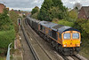 GBRF Class 66 No.66754 ' Northampton Saints' powers past Egham in charge of 4Y19  bringing gypsum hoppers from Mountfield Sidings  to Southampton W Docks <br /> <br /> 24 October 2017